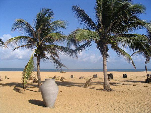 Negombo Beach | Image Credit: By S B from Sydney, Australia (Negombo Beach, Sri LankaUploaded by Ekabhishek) [CC BY 2.0], via Wikimedia Commons